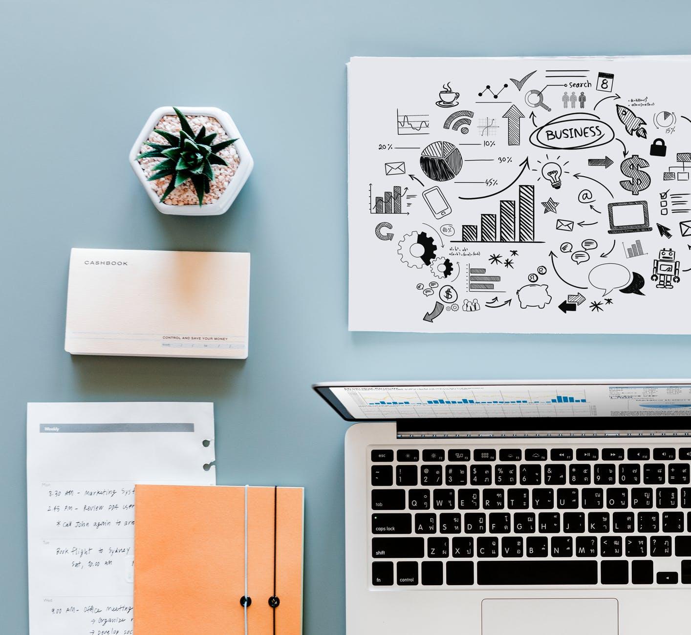 macbook air beside printing paper